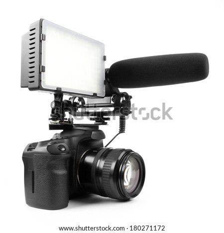 DSLR video camera isolated on white background with microphone and light #180271172