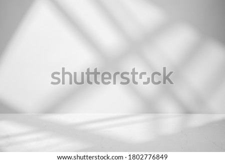 Gray background for product presentation with shadow and light from windows Royalty-Free Stock Photo #1802776849