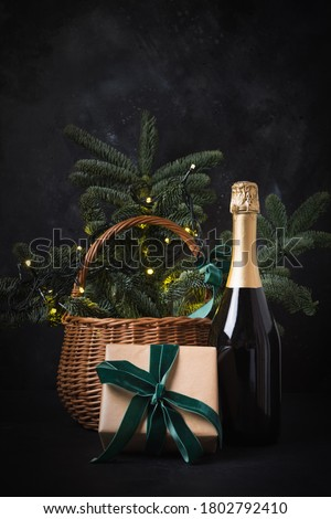 Holiday gift hamper with craft gift and sparkline wine on black. Christmas present. Happy New Year.