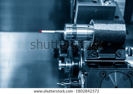 The touching probe attach on the CNC lathe machine .The quality control of hi-precision parts with  Coordinate Measuring Machine, CMM machine on turning machine. #1802842372