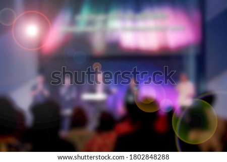 Worship God on Sunday with joy. /Picture blur effect./Concert in low light and lens flare.