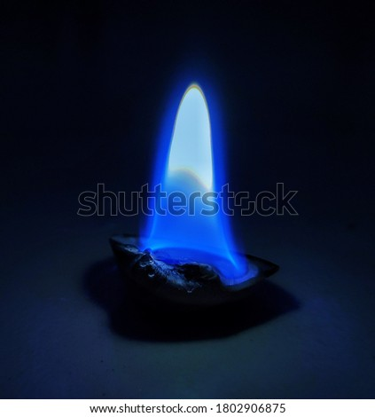 uttarakhand,India-22 july 2020:blue fire in dark.this is a picture of blue flame on shell at night.wallpaper photography.wallpaper.blue fire wallpaper.mobile and desktop best wallpaper.magical picture