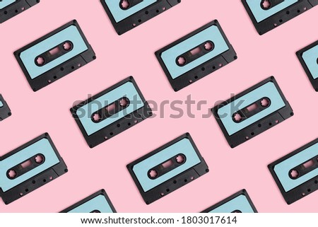 Cassette tapes pattern on a pink pastel background. Creative layout.