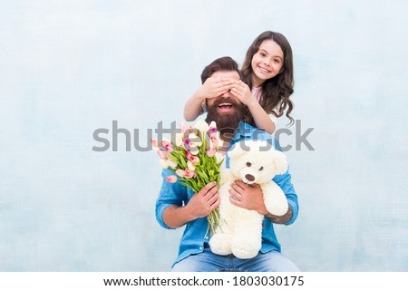 Guess who. Happy daughter clothes fathers eyes with hands. Playing guessing game. Birthday surprise. Surprise gift. Floral shop. Toyshop. Happy family. Spring holiday. Surprise concept, copy space. Royalty-Free Stock Photo #1803030175