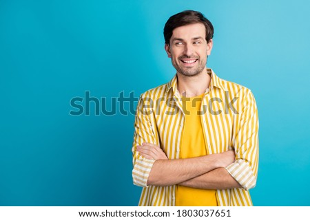 Photo of glad smart guy look copyspace cross hands enjoy business travel trip wear striped shirt isolated over blue color background