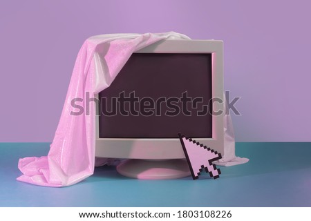 Vintage style concept with old Monitor screen and glitter fabric. Technology background. Retro fashion aesthetic. Royalty-Free Stock Photo #1803108226