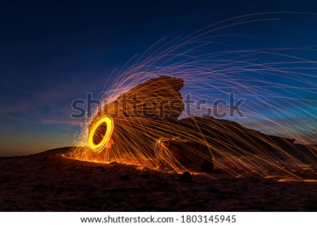 A steel wool on fire at night (night photography using a slow shutter speed) - selective focused on the subject.