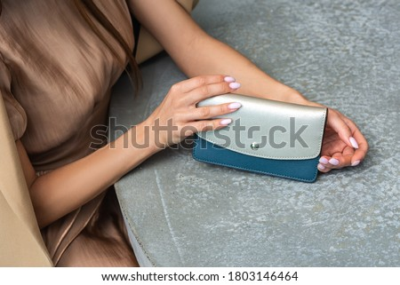 Girl with wallet at the table Royalty-Free Stock Photo #1803146464