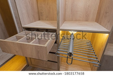 Interior design decor furnishing of luxury show home bedroom showing walk in wooden wardrobe closet furniture Royalty-Free Stock Photo #1803177658