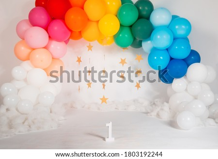 rainbow theme balloons arch for first birthday shoot Royalty-Free Stock Photo #1803192244
