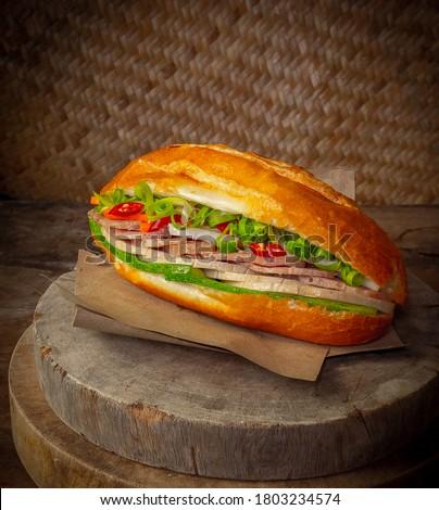 Vietnamese sandwich -Vietnamese Banh Mi in wood backgruond Royalty-Free Stock Photo #1803234574