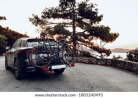 Crossover car with two road bicycles loaded on a rack Royalty-Free Stock Photo #1803240493