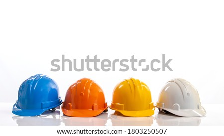Four construction helmets, hard safety helmet hat for engineer or worker isolated on white background Royalty-Free Stock Photo #1803250507