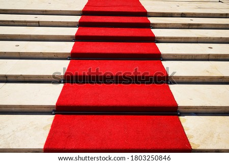 Red carpet on a stairway used to mark the route taken by heads of state, vips and celebrities on ceremonial and formal occasions or events.