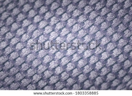 Blue vignetting dense fabric of synthetic braided threads as a background.