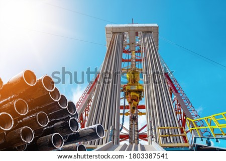 Oil and Gas Drilling Rig. Oil drilling rig operation on the oil platform in oil and gas industry. Top drive system of drilling rig #1803387541