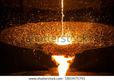 Pouring liquid metal from arc furnace Royalty-Free Stock Photo #1803475741