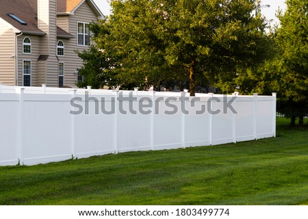 white vinyl fence outdoor backyard home private green Royalty-Free Stock Photo #1803499774