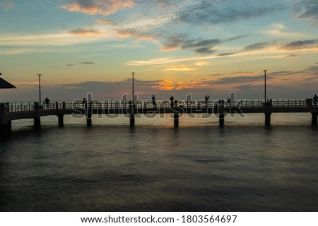 The silhouette of the pier in the sunset. #1803564697