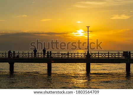 The silhouette of the pier in the sunset. #1803564709