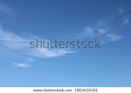 thin wispy clouds in perfect clear blue summer sky background #1803650182