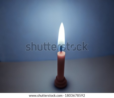 uttarakhand,india:candle with burning flame.this is a picture of a candle with burning flame on white background.this picture has vintage theme.burning candle wallpaper.