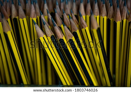 Yellow pencils in stock for school. Selective focus close up. High quality photo