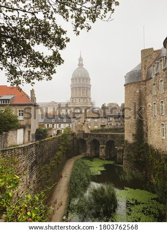 Basilica of Our Lady at the fortified city of Boulogne-sur-Mer, castle in foreground. Cloudy and rainy day with unrecognizable person Royalty-Free Stock Photo #1803762568
