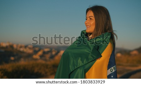 Happy girl with Brazil flag, independence day Royalty-Free Stock Photo #1803833929