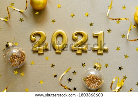 Happy New Years 2021. Christmas background with golden decorations, baubles, confetti. Christmas holiday celebration, winter, New Year concept.