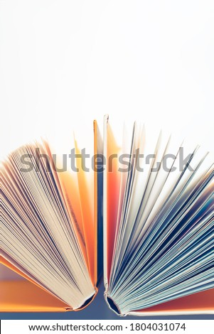 Opened  book. Pages on white background with orange covers. Top view on books with yellow hard covers.Abstract poste concept.