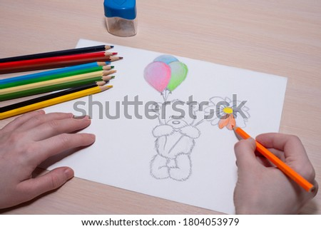 I am drawing a beautiful teddy bear with balls.