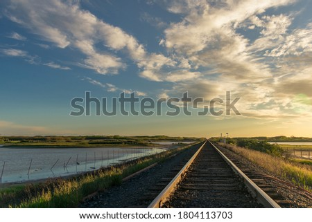 A picture of a railroad track at sunset near Saskatoon, Saskatchewan