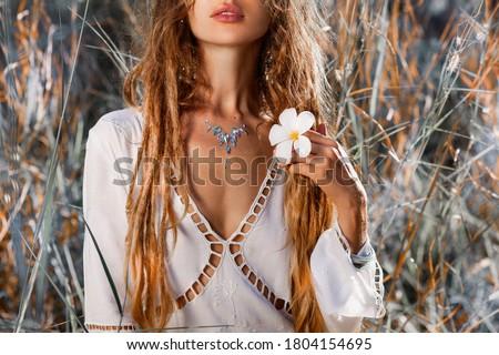 beautiful young woman with frangipani close up portrait Royalty-Free Stock Photo #1804154695
