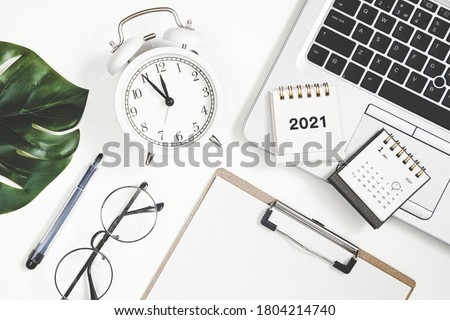 2021 new year goal, plan, action. Flat lay composition office desk with laptop and calendar. to do list Royalty-Free Stock Photo #1804214740