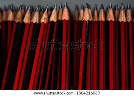 Red pencils in stock for school. Selective focus close up. High quality photo