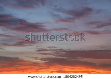 Defocus picture of twilight sky or evening sky after Sunset with gray clouds, blue and golden sky.