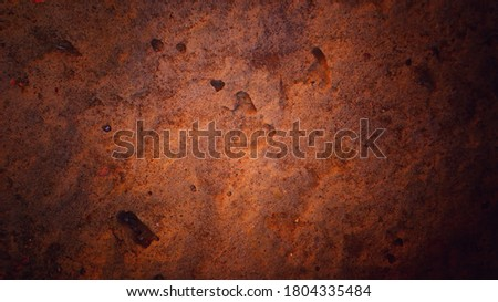 Textured orange vignetted concrete surface background with space for text