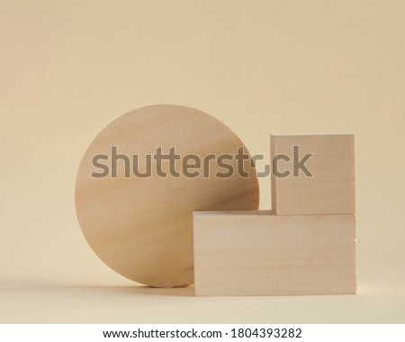 Wooden rectangular shapes on a beige background. Abstract geometric shapes. Empty podiums for your product. Minimalism