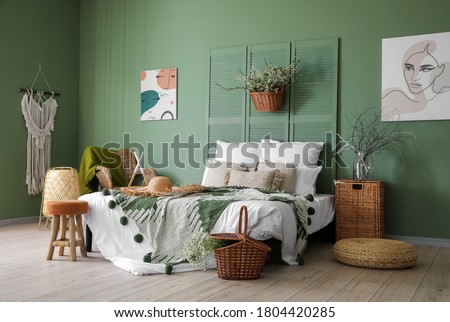 Interior of beautiful modern bedroom with spring flowers Royalty-Free Stock Photo #1804420285