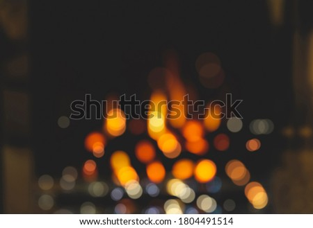 Blurry burning gas fireplace for Winter and Christmas background.