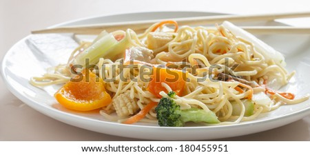 a plate of chicken chow mein #180455951