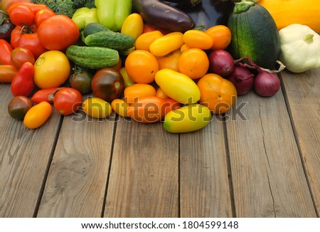 Many different non-starchy vegetables on a wooden background. Harvest and summer season concept.
