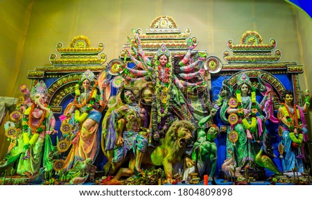 Durga Puja or Durgotsava,is an annual Hindu festival celebrated mainly in West Bengal,Indian.Durga is Goddess riding a lion with many arms each carrying weapon and defeating evil power of Mahishasura. #1804809898