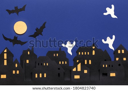 Modern paper cut flat lay with black halloween background. Cartoon character.