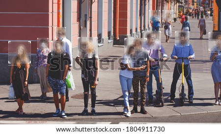 Face recognition and personal identification technologies in street surveillance cameras, law enforcement control. crowd of passers-by. data protection, Photo processing, noise, and blur effects Royalty-Free Stock Photo #1804911730