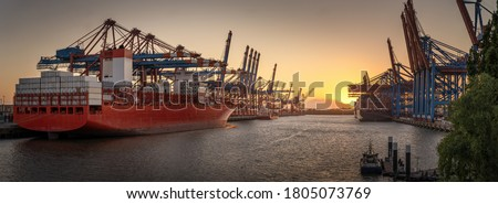 Container ships in the port of Hamburg at sunset  Royalty-Free Stock Photo #1805073769