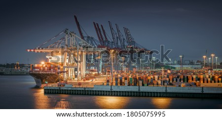 Panorama of a container terminal in the port of Hamburg at night  Royalty-Free Stock Photo #1805075995