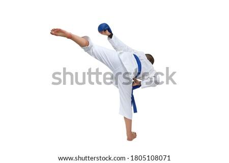 Athlete in karategi with blue belt training leg kick on white isolated background Royalty-Free Stock Photo #1805108071