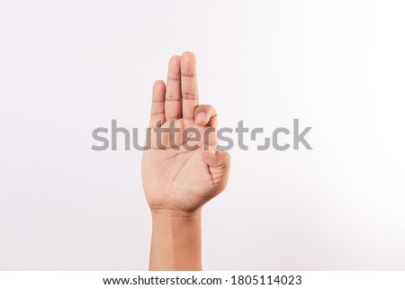 Letter F of the alphabet of Sign Language of Peru and America. Latin Peruvian man hands.